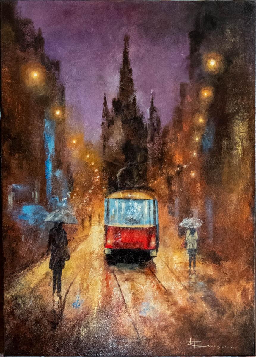 Tram sous la pluie de nuit
